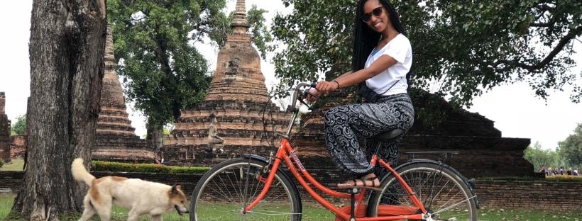 The Single Peach riding a bike